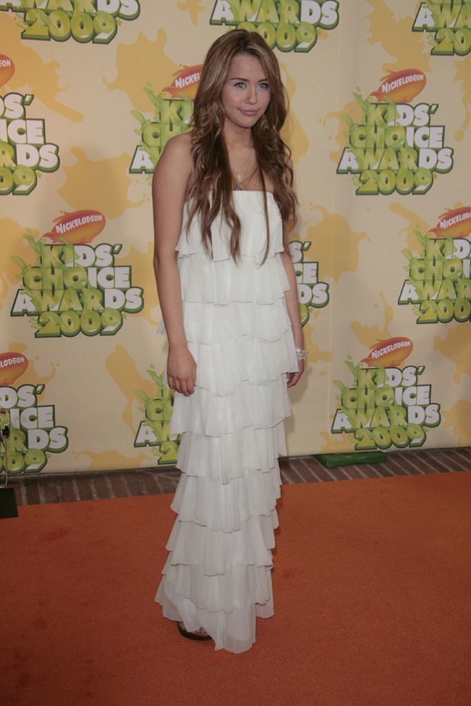 """Miley Cyrus, red carpet, white dress, Nickelodeon's 2009 Kids' Choice Awards at the UCLA Pauley Pavillion, Los Angeles, America - 28 Mar 2009High School Musical 3: Senior Year"""" has received top marks at the Kids' Choice Awards. The Disney musical was selected as the favourite movie by audience votes at Nickelodeon's 22nd annual event. """"High School Musical"""" star Vanessa Hudgens was also selected as the favourite movie actress. However, it was the slime not the awards that was the most popular part of the evening. The show was kicked off by host Dwayne 'The Rock' Johnson zip-lining into a """"slime temple"""" and spraying goo over the audience. Over 90 million viewer votes were cast on Nickelodeon's website for this year's awards."""