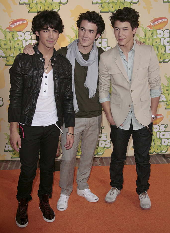 """Jonas Brothers - Joe Jonas, Kevin Jonas and Nick JonasNickelodeon's 2009 Kids' Choice Awards at the UCLA Pauley Pavillion, Los Angeles, America - 28 Mar 2009 High School Musical 3: Senior Year"""" has received top marks at the Kids' Choice Awards. The Disney musical was selected as the favourite movie by audience votes at Nickelodeon's 22nd annual event. """"High School Musical"""" star Vanessa Hudgens was also selected as the favourite movie actress. However, it was the slime not the awards that was the most popular part of the evening. The show was kicked off by host Dwayne 'The Rock' Johnson zip-lining into a """"slime temple"""" and spraying goo over the audience. Over 90 million viewer votes were cast on Nickelodeon's website for this year's awards."""