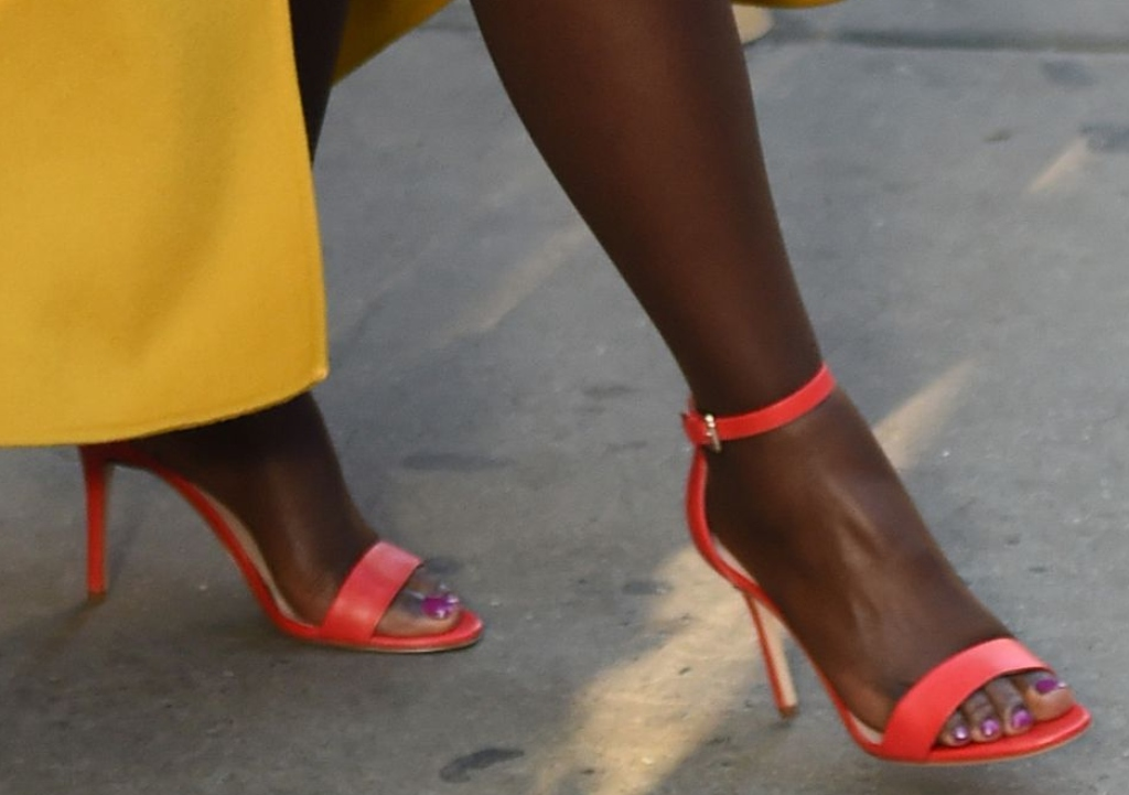 Lupita Nyong'o, red leather sandals