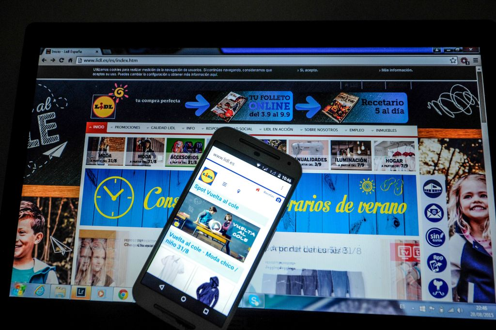 Computer screen and phone screen showing a retailer's webpage