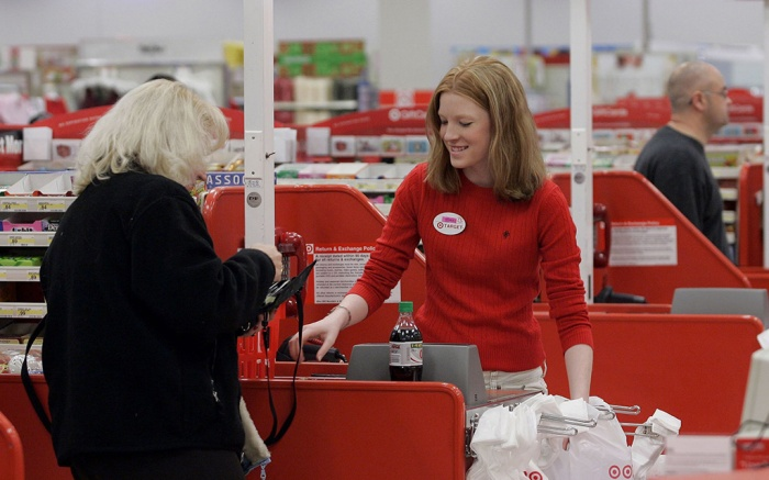 TARGET Cashier Nora Poage rings up a purchase at a Target store in Seattle Wash. A federal appeals court has handed a defeat to a coalition of retail groups that challenged as too high the Federal Reserve's cap on how much banks can charge businesses for handling debit card transactions. The ruling issued Friday, March 21, 2014 by the U.S. Appeals Court for the District of Columbia overturned a lower court's decision in July that favored the merchants and was a setback for banksDebit card fees, SEATTLE, USA