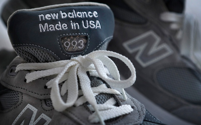 """A pair of New Balance running shoes is displayed, in Freeport, Maine. On Wednesday the Maine's congressional delegation is visiting a factory that's going to benefit from a """"Made-in-USA"""" provision for sneakers for military recruits. Rep. Bruce Poliquin and Sens. Susan Collins and Angus King will celebrate a provision that's included in the defense spending bill, which President Barack Obama is expected to signMilitary Sneakers, Freeport, USA - 14 Dec 2016"""