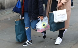 Shoppers carry bags in London, Britain,