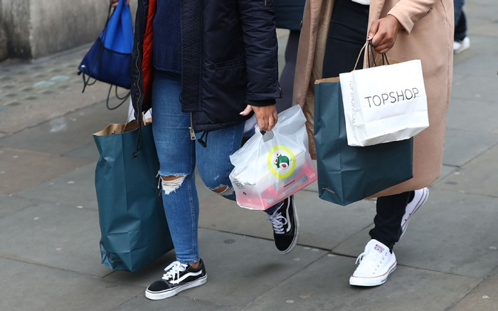 Shoppers carry bags in London, Britain, 24 November 2017. Black Friday is a huge shopping event which sees people all over the world getting discounted products as retailers slash prices. This year shoppers choose to shop online rather than traditionally queuing up through the night outside the shops before opening hoursBlack Friday in London, United Kingdom - 24 Nov 2017