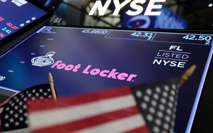 The logo for Foot Locker appears above a trading post on the floor of the New York Stock ExchangeFinancial Markets Wall Street Earns Foot Locker, New York, USA - 02 Mar 2018