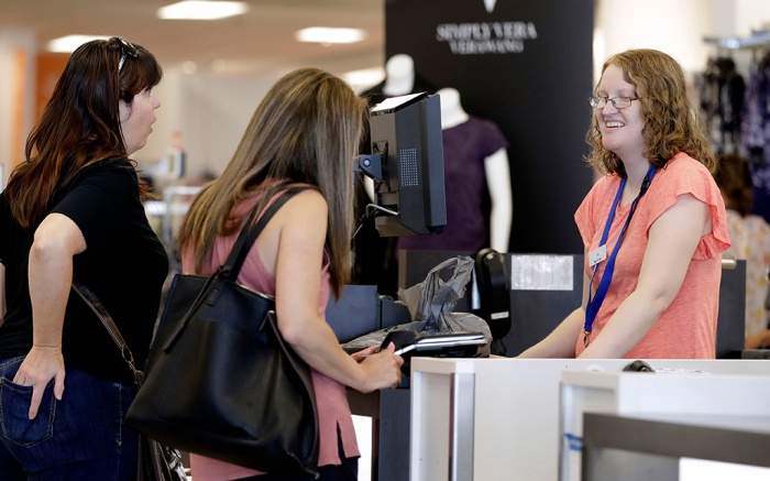 Liz Moore, Chrisite Meeks. Cashier Liz Moore, right, checks out customers Christie Meeks, center, and Lisa Starnes, left, at a Kohl's store in Concord, N.C. Many kinds of chains have posted strong sales, both online and at stores. A booming economy, which has shoppers spending more freely, and companies' own efforts in trying to Amazon-proof their business is driving people's mood to spendMood To Spend, Concord, USA - 28 Aug 2018