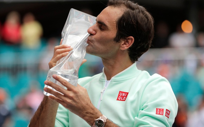 Roger Federer, of Switzerland, kisses the trophy after defeating John Isner during the singles final of the Miami Open tennis tournament, in Miami Gardens, FlaMiami Open Tennis, Miami Gardens, USA - 31 Mar 2019