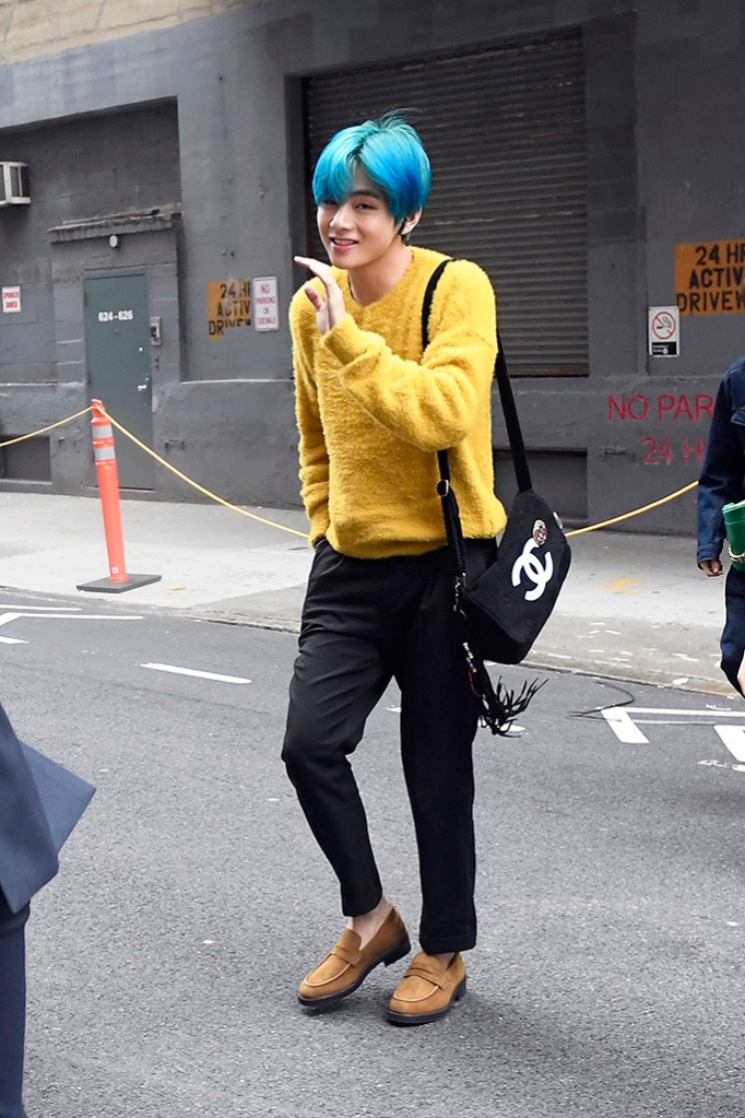 V, Chanel bag, brown loafers, yellow sweater, BTS Band Members arriving at tv studios this morning in New York CityPictured: Kim Tae-Hyung,VRef: SPL5079416 120419 NON-EXCLUSIVEPicture by: Elder Ordonez / SplashNews.comSplash News and PicturesLos Angeles: 310-821-2666New York: 212-619-2666London: 0207 644 7656Milan: 02 4399 8577photodesk@splashnews.comWorld Rights, No Portugal Rights