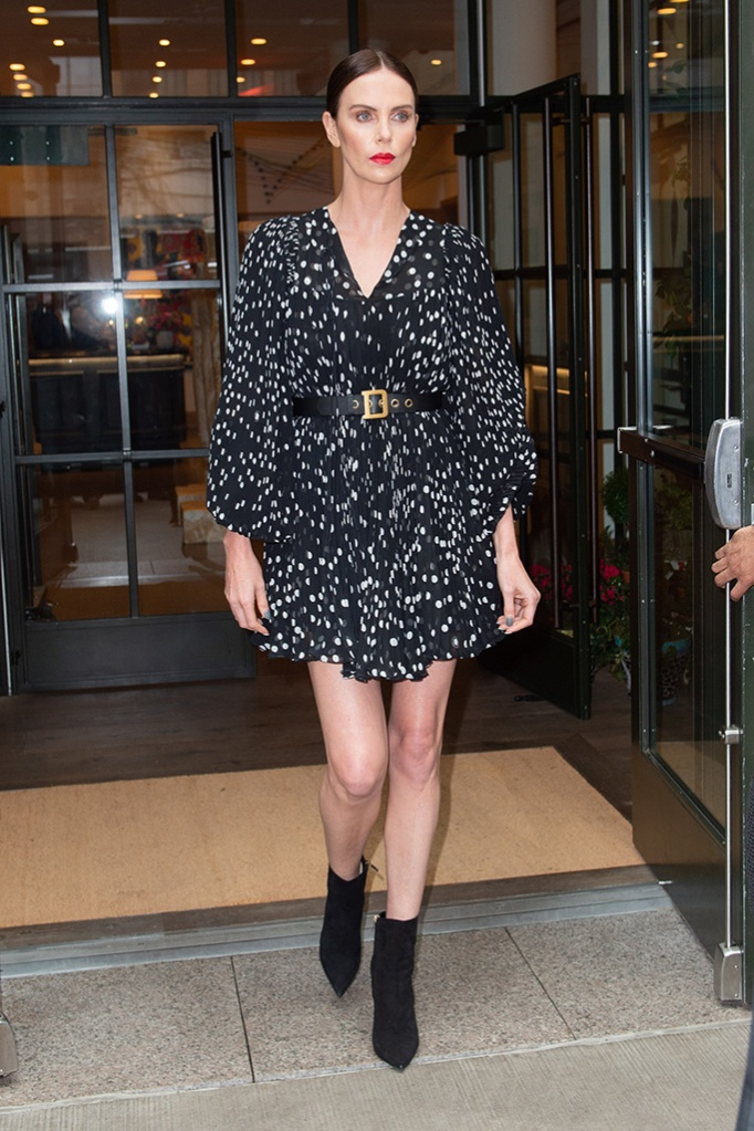 Charlize Theron, legs, dior belt, black and white polka-dot minidress, black booties, leaves her hotel in NYC.Pictured: Charlize TheronRef: SPL5084787 300419 NON-EXCLUSIVEPicture by: Ron Asadorian / SplashNews.comSplash News and PicturesLos Angeles: 310-821-2666New York: 212-619-2666London: 0207 644 7656Milan: 02 4399 8577photodesk@splashnews.comWorld Rights