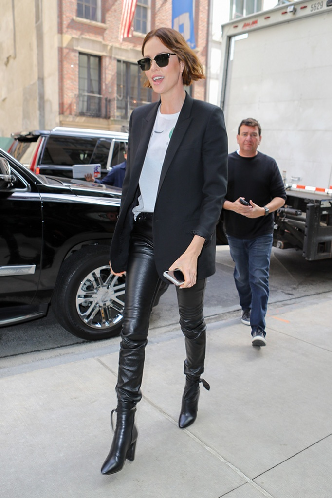 Charlize Theron, leather leggings, legs, saint laurent ankle boots, celebrity style, seen arriving back at her hotel in New York CityPictured: Charlize TheronRef: SPL5084318 290419 NON-EXCLUSIVEPicture by: Felipe Ramales / SplashNews.comSplash News and PicturesLos Angeles: 310-821-2666New York: 212-619-2666London: 0207 644 7656Milan: 02 4399 8577photodesk@splashnews.comWorld Rights