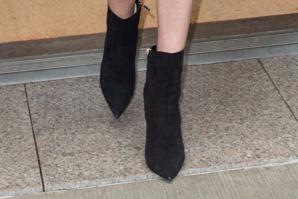 charlize theron, black suedelike booties, new york city, celebrity shoe style, april 2019
