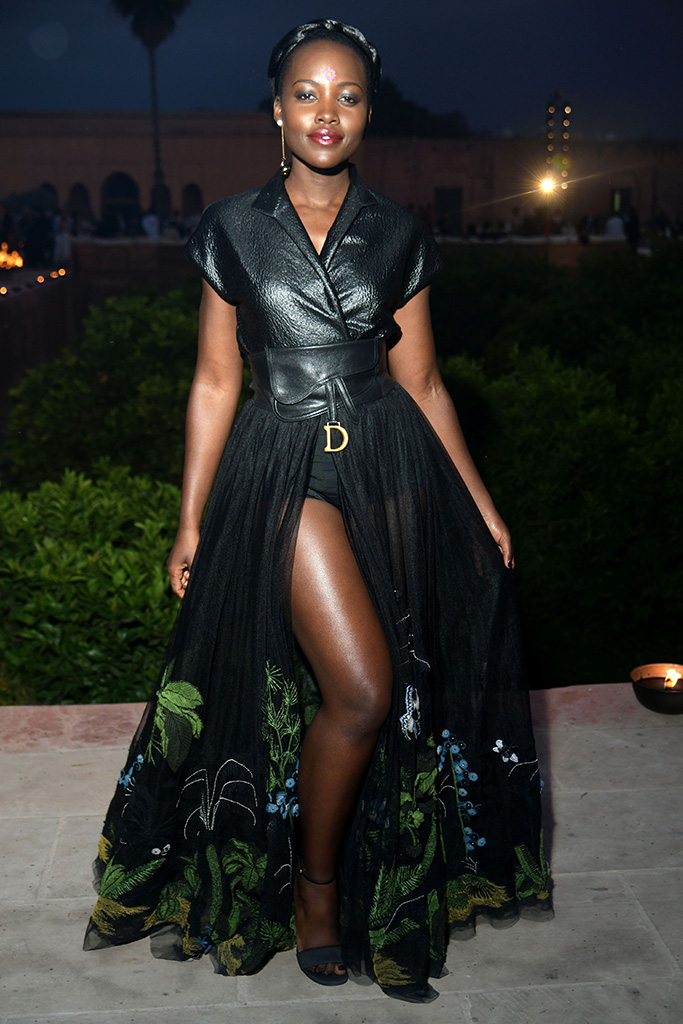Lupita Nyong'o, leggy black dress, ankle-strap sandals, celebrity style, in the front rowDior Cruise 2020 show, Front Row, Palais El Badi, Marrakech, Morocco - 29 Apr 2019