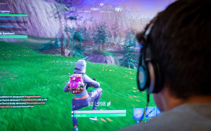 Teenager playing Fortnite video game, Fortnite is a web based multi player survival game developed by Epic Games.Teenager playing Fortnite video game, UK - 13 Jun 2018fortnite