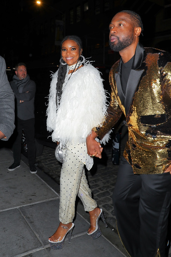 Dwyane Wade and Gabrielle Union seen all smiling while arriving at the 70's party at Catch in New York City, Dwyane throw a party for his retirementPictured: Dwyane Wade and Gabrielle Union Ref: SPL5079026 100419 NON-EXCLUSIVE Picture by: Felipe Ramales / SplashNews.com Splash News and Pictures Los Angeles: 310-821-2666 New York: 212-619-2666 London: 0207 644 7656 Milan: 02 4399 8577 photodesk@splashnews.com World Rights