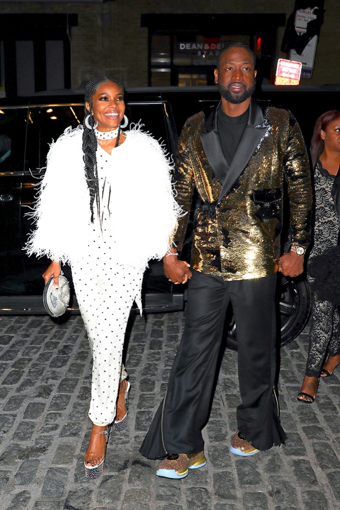 Dwyane Wade and Gabrielle Union seen all smiling while arriving at the 70's party at Catch in New York City, Dwyane throw a party for his retirementPictured: Dwyane Wade and Gabrielle UnionRef: SPL5079026 100419 NON-EXCLUSIVEPicture by: Felipe Ramales / SplashNews.com, celebrity couple, celeb style, feathered coat, sparkly blazer,
