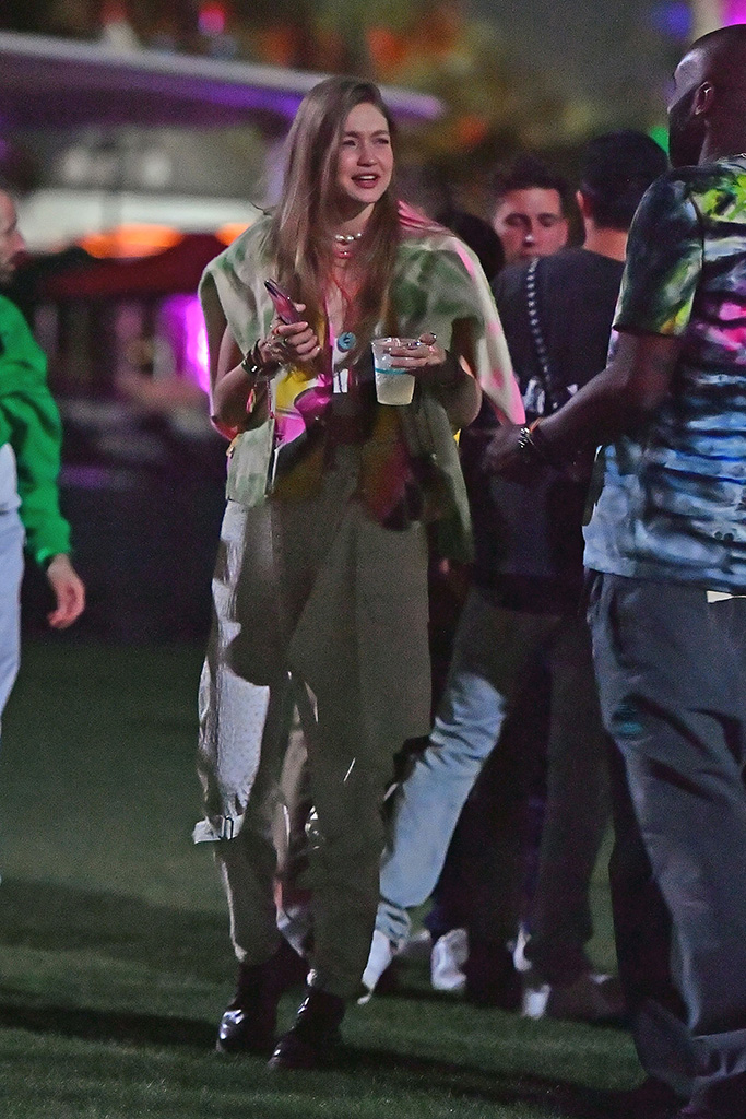 Gigi Hadid, ganni, white pants, tie-dye vest, black combat boots, street style, coachella, is seen hanging at Coachella with friends. 12 Apr 2019 Pictured: Gigi Hadid. Photo credit: marksman / MEGA TheMegaAgency.com +1 888 505 6342 (Mega Agency TagID: MEGA399477_002.jpg) [Photo via Mega Agency]