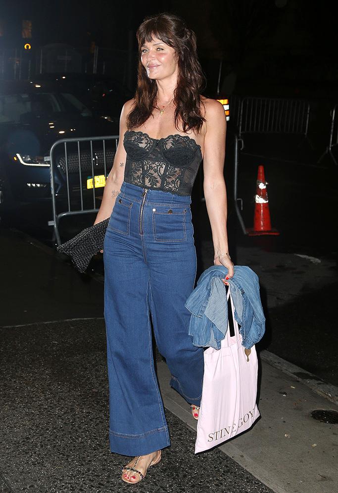 Helena Christensen, flared denim pants, jeweled t-strap flat sandals, lace bustier top, Gigi Hadid Birthday Party, New York, USA - 22 Apr 2019