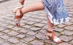 Girl wearing sandals and blue dress