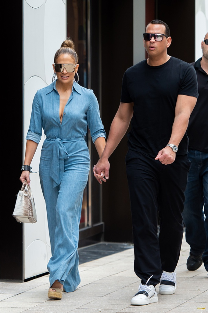 Jennifer Lopez, denim jumpsuit, cleavage, street style, april 2019, celebrity style, wedge sandals, sunglasses, and Alex Rodriguez take their kids out for a family lunch in Miami. The newly engaged couple took Ella, Natasha, Maximilian and Emma out to Miami Design District for a full family lunch. Ella Who is Alex Rodriguez's younger daughter is celebrating her 11th birthday this Weekend.Pictured: Ref: SPL5081314 200419 NON-EXCLUSIVEPicture by: AM / SplashNews.comSplash News and PicturesLos Angeles: 310-821-2666New York: 212-619-2666London: 0207 644 7656Milan: 02 4399 8577photodesk@splashnews.comWorld Rights