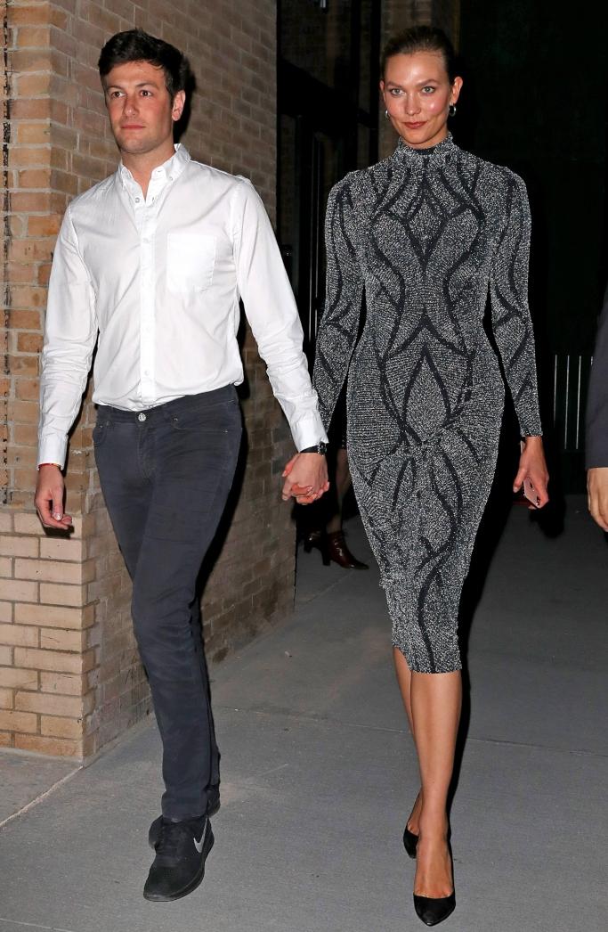Karlie Kloss and Joshua Kushner holding hands