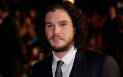 Actor Kit Harrington poses for photographers