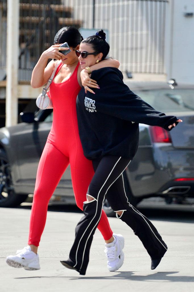 Kylie Jenner, Adidas Falcon, celebrity style, red bodysuit