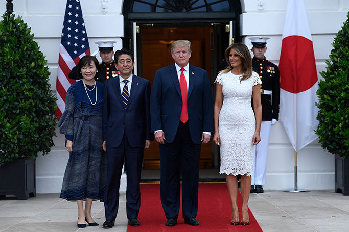 Donald Trump, Shinzo Abe, Melania Trump. President Donald Trump, third from right, and first lady Melania Trump, second from right, welcome Japanese Prime Minister Shinzo Abe, third from left, and his wife Akie Abe, left, to the South Lawn of the White House in Washington, . The Trumps are hosting the Abes for dinner at the White HouseTrump US Japan, Washington, USA - 26 Apr 2019