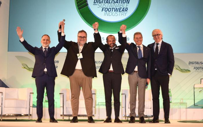The organizing committe of the 6th World Footwear Congress held in Naples.
