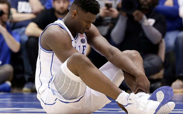 Duke's Zion Williamson sits on the floor following a injury during the first half of an NCAA college basketball game against North Carolina, in Durham, N.C., . Duke might have to figure out what the Zion Show will look like without its namesake. All because of a freak injury to arguably the most exciting player in college basketball. As his Nike shoe blew out, Williamson sprained his right knee on the first possession of what became top-ranked Duke's 88-72 loss to No. 8 North CarolinaNorth Carolina Duke Basketball, Durham, USA - 20 Feb 2019