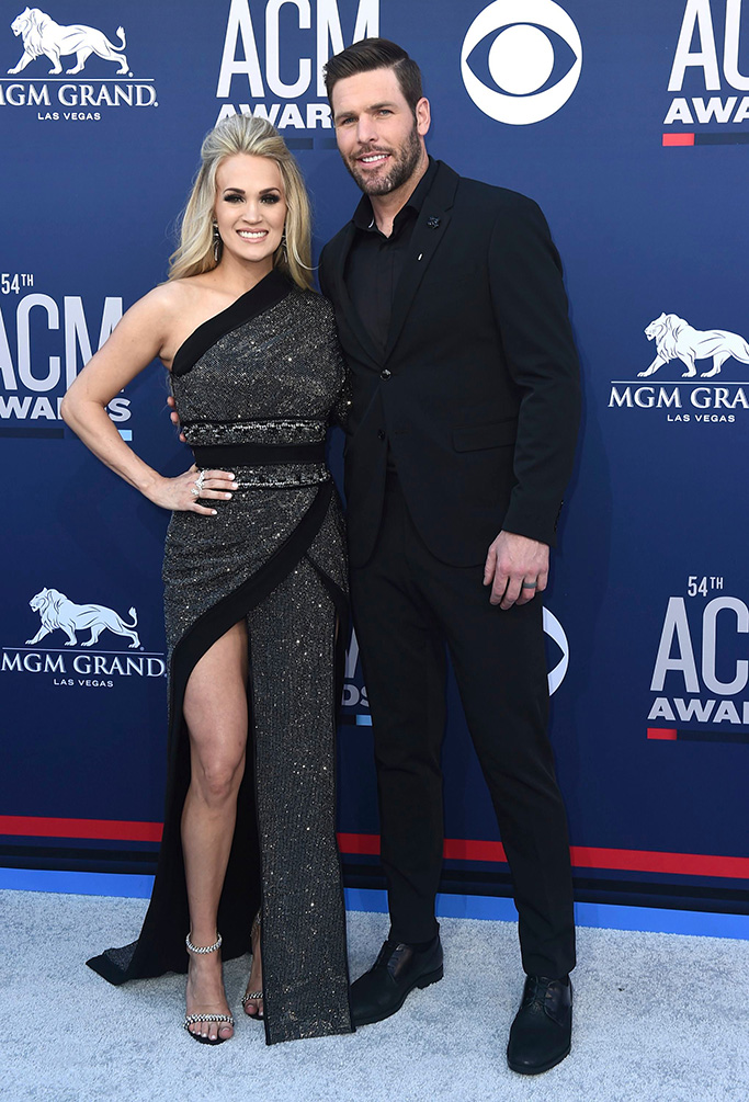 Carrie Underwood, Mike Fisher. Carrie Underwood, left, and Mike Fisher arrive at the 54th annual Academy of Country Music Awards at the MGM Grand Garden Arena, in Las Vegas54th Annual Academy of Country Music Awards - Arrivals, Las Vegas, USA - 07 Apr 2019