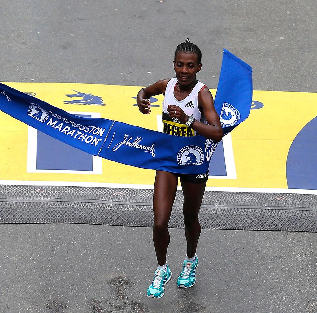 Worknesh Degefa of Ethiopia crosses the finish line to win the Women's Division of the 123th Boston Marathon in Boston, Massachusetts, USA, 15 April 2019.Running of the 123rd Boston Marathon, USA - 15 Apr 2019