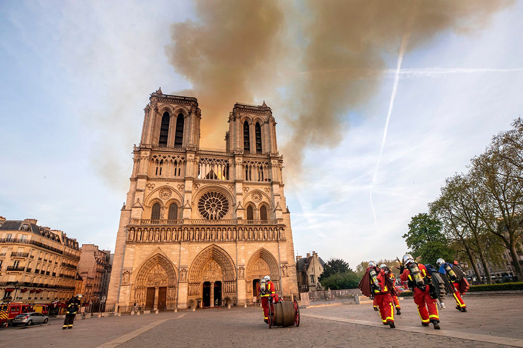 This photo provided by the Paris Fire Brigade shows fire fighters heading to the burning Notre Dame cathedral, Monday April 15, 2019. Experts assessed the blackened shell of Paris' iconic Notre Dame Tuesday morning to establish next steps to save what remains after a devastating fire destroyed much of the cathedral that had survived almost 900 years of historyNotre Dame Fire, Paris, France - 15 Apr 2019