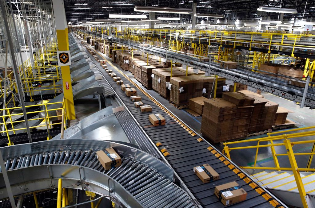 Packages ride on a conveyor system at an Amazon fulfillment center in Baltimore. Outside of ditching online shopping altogether, there are some small tweaks in how you shop that can cut down on the impact on the environment, such as slowing down shipping times and not filling up the cart with stuff you know you won't keepOn The Money Online Shopping-Environment, Baltimore, USA - 03 Aug 2017