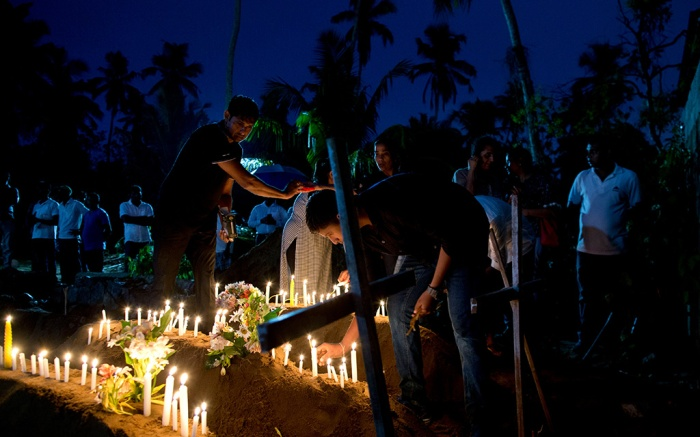 Relatives light candles after the burial of three victims of the same family, who died at Easter Sunday bomb blast at St. Sebastian Church in Negombo, Sri Lanka, . Easter Sunday bombings of churches, luxury hotels and other sites was Sri Lanka's deadliest violence since a devastating civil war in the South Asian island nation ended a decade agoChurch Blasts, Negombo, Sri Lanka - 22 Apr 2019