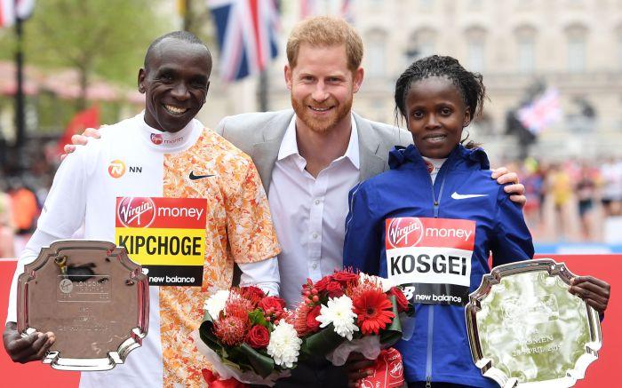 Britain's Prince Harry (C), the Duke of Sussex, poses with men's race winner Kenya's Eliud Kipchoge (L) and women's race winner, Kenya's Brigid Kosgei (R) at the medal ceremony during the 2019 Virgin Money London Marathon in London, Britain, 28 April 2019.London Marathon 2019, United Kingdom - 28 Apr 2019