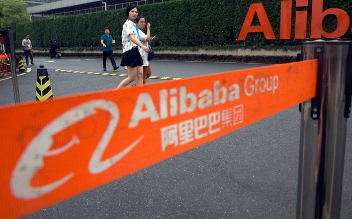 Workers walk past a checkpoint into the Alibaba Group headquarters in Hangzhou, in eastern China's Zhejiang province on . Alibaba began 17 years ago in the modest living room of a gutsy man with a history of failure. Jack Ma struggled in school, and even Kentucky Fried Chicken refused to hire him. Today, Alibaba is a $15.7 billion e-commerce ecosystem that supports the livelihoods of tens of millions of merchants. Some 423 million shoppers last fiscal year picked through the billion listings that Alibaba's platforms host on any given dayChina Alibaba, Hangzhou, China