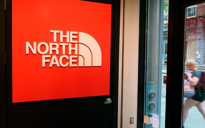 In this, a person walks by The North Face store in New YorkEarns The North Face, New York, USA - 13 Aug 2018