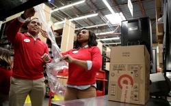 Employees demonstrate how air pillow machines