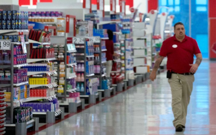 A store employee walks under a back-to-school display at the CityTarget store in Boston