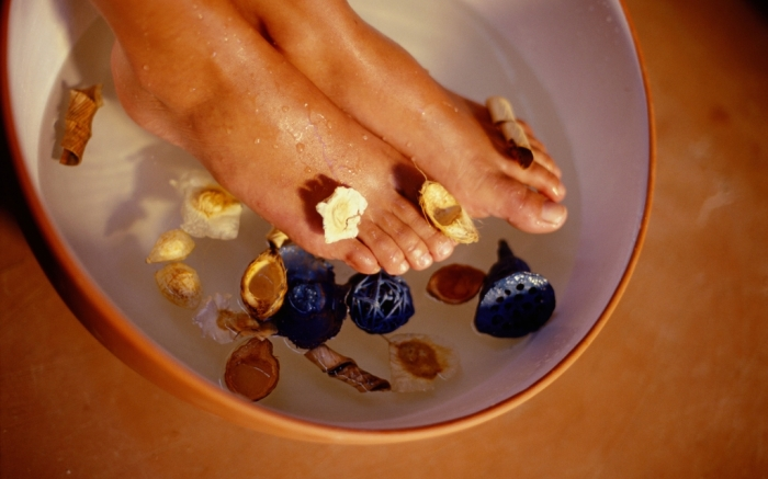 MINIMUM USAGE FEE £35. Please call Rex Features on 020 7278 7294 with any queriesMandatory Credit: Photo by Juice/REX/Shutterstock (7540421a)MODEL RELEASED Woman's feet soaking in bowlVARIOUS