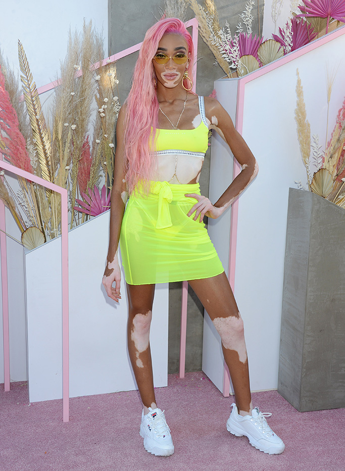 Winnie Harlow, fila disruptor ii sneakers, highlighter yellow set, Revolve Party, Coachella Valley Music and Arts Festival, Weekend 1, Day 2, La Quinta, USA - 13 Apr 2019