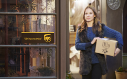 Woman carries package to UPS access