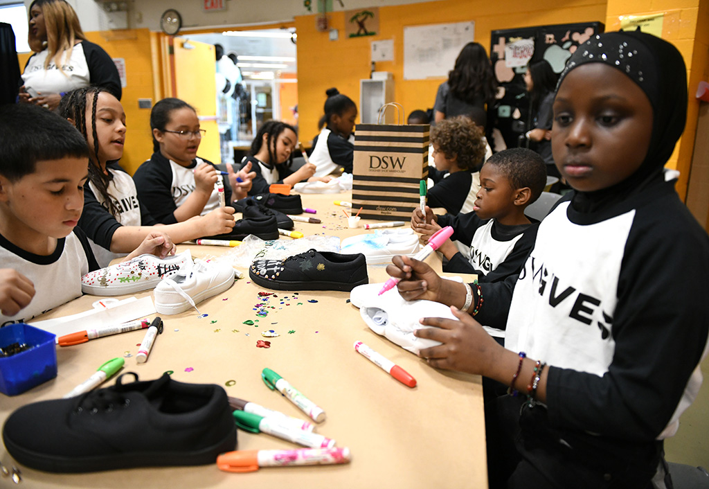NEW YORK, NEW YORK - MAY 09: Students attend as Former NFL Star Victor Cruz kicks off DSW's Shoe Donation Summer Campaign at BronxWorks Community Center on May 09, 2019 in New York City. (Photo by Bryan Bedder/Getty Images for DSW)