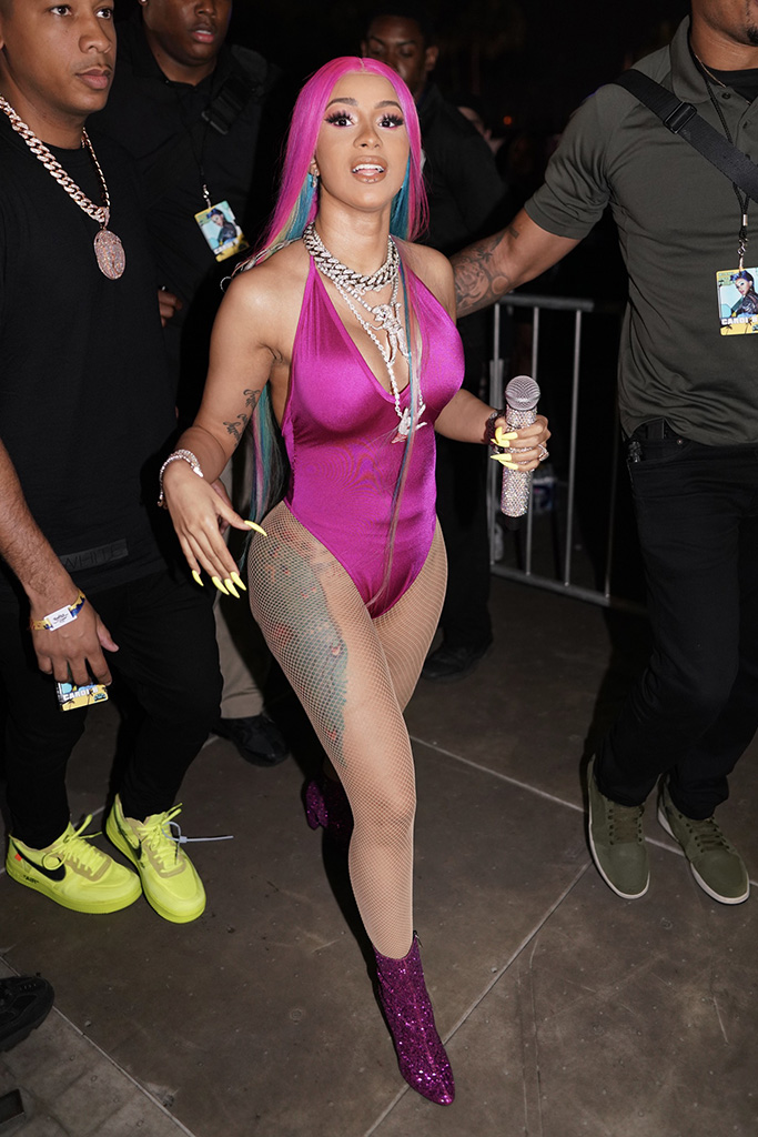 Cardi B, pink bodysuit, fishnet stockings, glittery saint laurent ankle boots, celebrity style, in sexy pink outfit at rolling loud MiamiPictured: Ref: SPL5088429 110519 NON-EXCLUSIVEPicture by: ShotbyJuliann / SplashNews.comSplash News and PicturesLos Angeles: 310-821-2666New York: 212-619-2666London: 0207 644 7656Milan: 02 4399 8577photodesk@splashnews.comWorld Rights