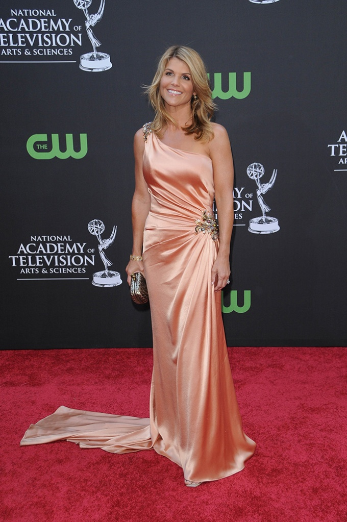 Lori Loughlin36th Annual Daytime Emmy Awards, Orpheum Theatre, Los Angeles, America - 30 Aug 2009 Rachael Ray and Tyra Banks were awarded the top talk show prizes for their Food Network show and 'America's Top Model' respectively. Ray also won for best entertainment talk show and Banks was honoured with the gong for best informative talk show. Ellen DeGeneres was runner-up in the best talk show host category. Shows picking up numerous Emmys included 'All My Children', 'One Life To Live', 'The View', 'El Tigre', 'Sesame Street' and 'The Ellen DeGeneres Show'.