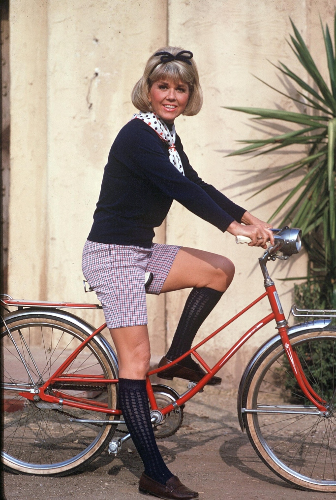 Doris Day pictured on a bicycle in 1973