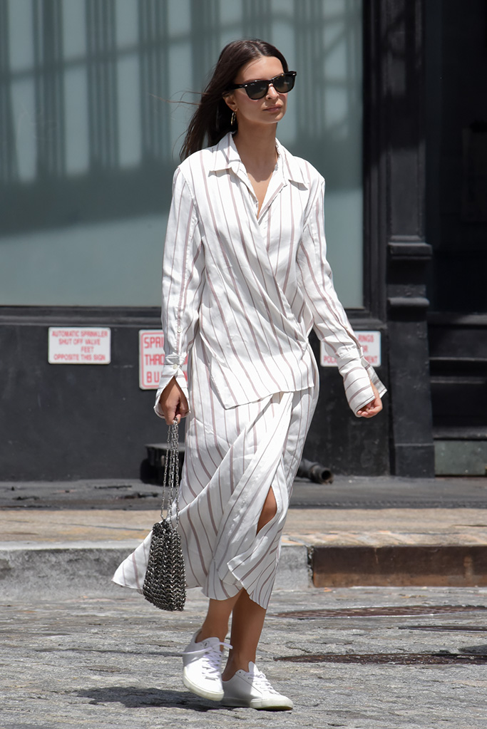 Emily Ratajkowski, joseph Claudi dress walking in Soho wearing a white dress holding her metallic purse on Friday, May 24th, 2019.Pictured: Ref: SPL5093358 240519 NON-EXCLUSIVEPicture by: Luis Yllanes / SplashNews.comSplash News and PicturesLos Angeles: 310-821-2666New York: 212-619-2666London: 0207 644 7656Milan: 02 4399 8577photodesk@splashnews.comWorld Rights
