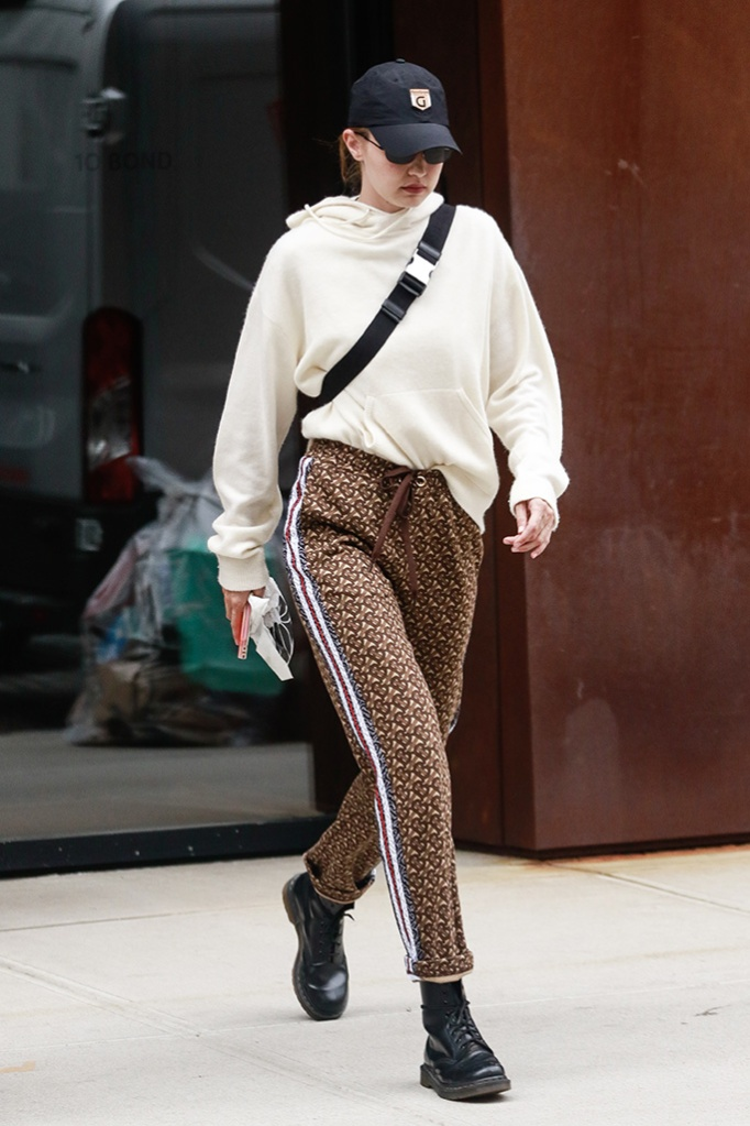 Gigi Hadid, dr. martens boots, mandkhai cashmere sweater, dr. martens boots, celebrity style, reebok baseball cap, Gigi Hadid out and about, New York, USA - 28 May 2019Wearing Burberry, Trousers