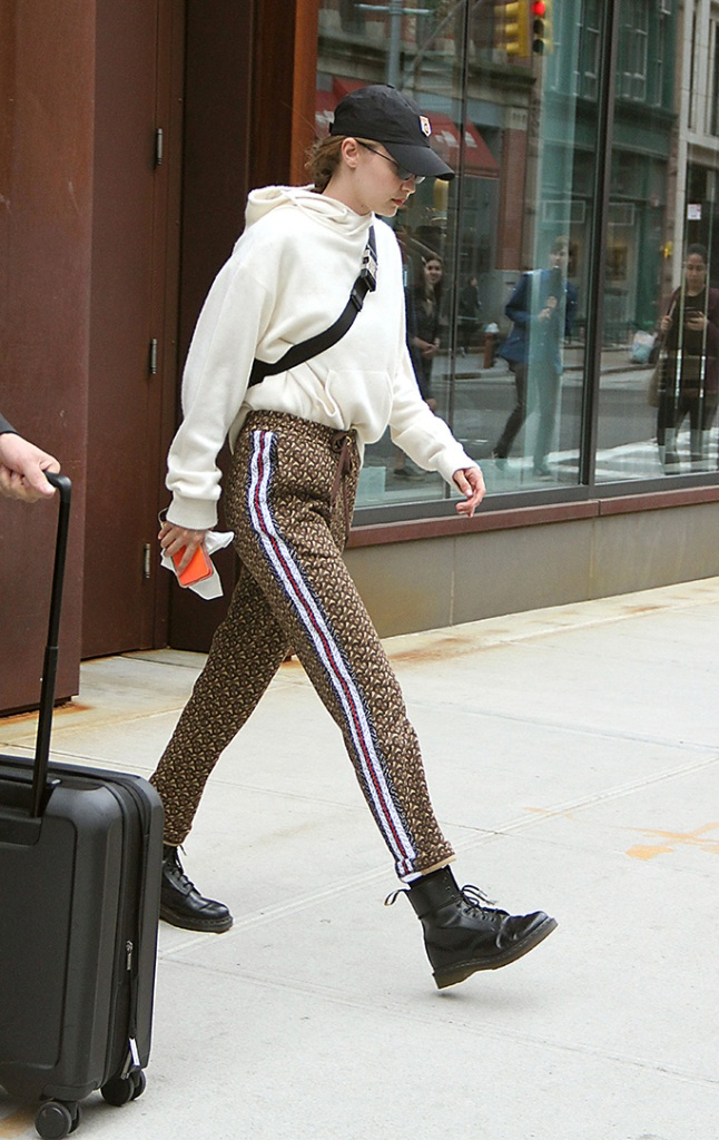 Gigi Hadid, dr. martens mono 1460 boots, Gigi Hadid out and about, New York, USA - 28 May 2019Wearing Burberry, Trousers, burberry track pants, cashmere sweater, reebok baseball cap, celebrity street style,