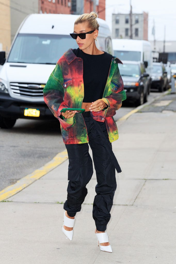 hailey baldwin, crop top, msgm tie-dye jacket, represent technical military pants, white pointy-toe mules, stilettos,